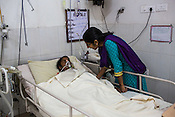 Dr. Sharon Cynthia tries to speaks to 22 year old Shivsagar Devi at the intensive care unit of the Duncan Hospital in Raxaul, Bihar, India.