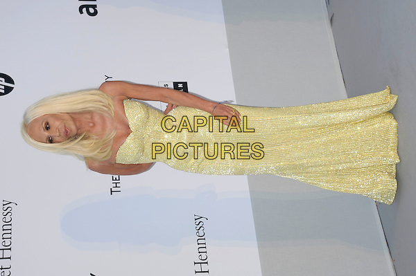 DONATELLA VERSACE.amfAR's Cinema Against AIDS Gala during the 64th Annual Cannes Film Festival at Hotel Du Cap, Antibes, France, May 19th, 2011..full length dress yellow strapless sequined sequin sparkly .CAP/PL.©Phil Loftus/Capital Pictures
