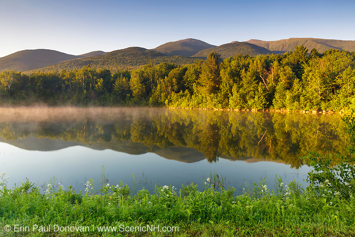 Northern Presidential Range from Durand Lake in Randolph, New Hampshire at sunrise during the summer months.