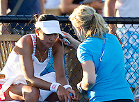 ANNE KEOTHAVONG (GBR) against MONA BARTHEL (GER) in the First Round of the Women's Singles. Mona Barthel beat Anne Keothavong 6-0 retired..16/01/2012, 16th January 2012, 16.01.2012..The Australian Open, Melbourne Park, Melbourne,Victoria, Australia.@AMN IMAGES, Frey, Advantage Media Network, 30, Cleveland Street, London, W1T 4JD .Tel - +44 208 947 0100..email - mfrey@advantagemedianet.com..www.amnimages.photoshelter.com.