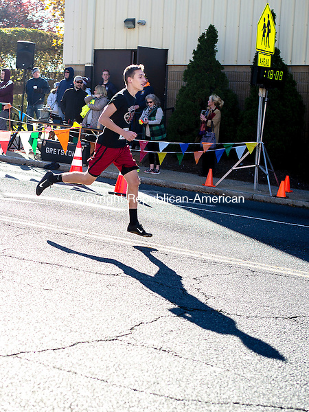 Waterbury, CT- 12 November 2016-111216CM01- Jonathan Warren warms up before the start of a Veteran's Day 5K road race in downtown Waterbury on Saturday.  The event put on by Sacred Heart High School benefited the Sacred Heart High School Scholarship Assistance Program and the Wounded Warriors Project.  Approximately 250 participants entered the race said Mike Madden, one of the event organizers and Assistant Director of Athletics at the school.    Christopher Massa Republican-American