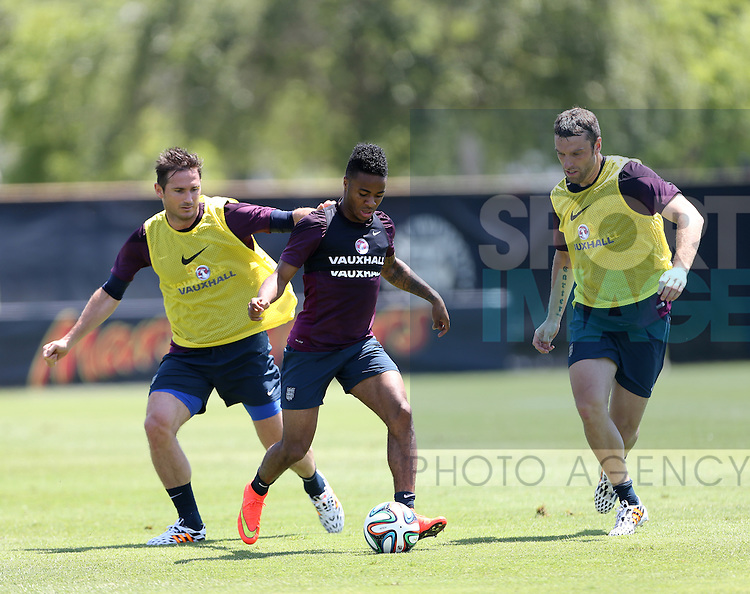 England's Frank Lampard and Rickie Lambert tussle with Raheem Sterling during training<br /> <br /> England Training &amp; Press Conference  - Barry University - Miami - USA - 06/06/2014  - Pic David Klein/Sportimage