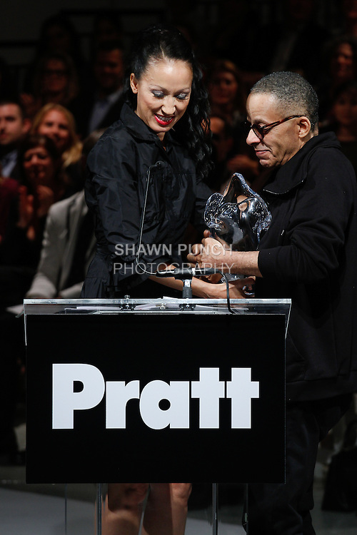 "Supermodel Pat Cleveland hands designers Stephen Burrows his 2014 Pratt Fashion Award for Lifetime Achievement, at the 115th Annual Pratt Institute 2014 ""Under Construction"" collection Student Runway Show;  at Center548 in NYC, on May 1, 2014."