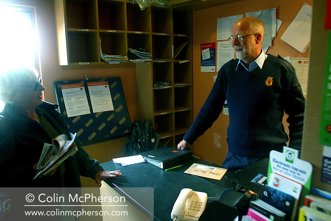 Postman John Cormack in the tiny post office at Galmisdale on the Hebridean island of Eigg chatting to a customer. The island of Eigg was one of a chain of islands which lie of Scotland's west coast and was accessible by a state-run lifeline service from the mainland. The residents on Eigg organised a buy-out of the island in the late 1990s and took it into community ownership...