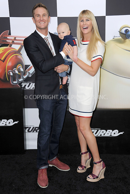 WWW.ACEPIXS.COM<br /> July 9, 2013...New York City <br /> <br /> Ryan Hunter-Reay, Ryden Hunter-Reay, and Beccy Hunter-Reay attending the DreamWorks Animation, in Association with 20th Century Fox Premiere of TURBO<br /> at AMC Loews Lincoln Square, New York, NY on July 9, 2013.<br /> <br /> Please byline: Kristin Callahan... ACE<br /> Ace Pictures, Inc: ..tel: (212) 243 8787 or (646) 769 0430..e-mail: info@acepixs.com..web: http://www.acepixs.com
