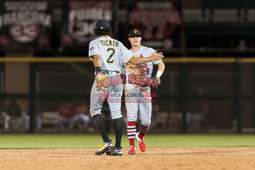 Surprise Saguaros second baseman Andy Young (29), of the St. Louis Cardinals organization, is congratulated by Cole Tucker (2) after making a diving play during an Arizona Fall League game against the Scottsdale Scorpions at Scottsdale Stadium on October 15, 2018 in Scottsdale, Arizona. Surprise defeated Scottsdale 2-0. (Zachary Lucy/Four Seam Images)