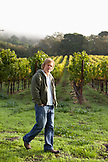 USA, California, Sonoma, Gundlach Bundschu Winery, sixth generation vineyard owner and manager Jeff Bundschu walking in the vines