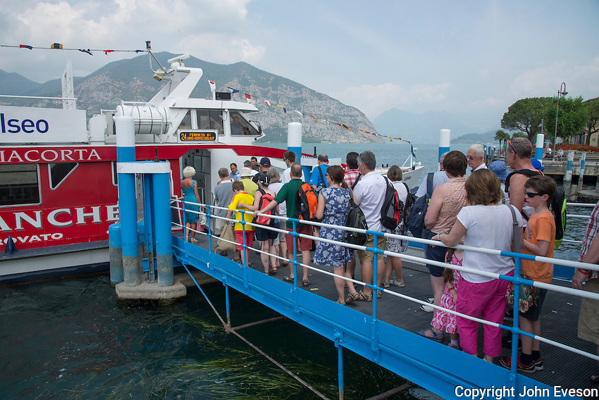 Boarding the Sebino water bus on Lake Iseo, Lombardy, Italy.
