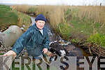 DEAD FOAL: Pat O'Shea Chairman of the Curraheen Community Council who came across a dead foal dumped into a river at Derrymore beach yesterday (Wednesday) morning.