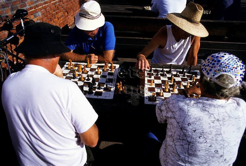 Four people playing chess