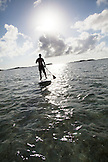 EXUMA, Bahamas. Grant doing stand up paddling at the Fowl Cay Resort.