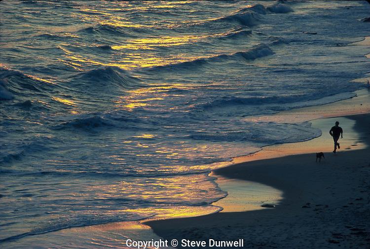 man running along shore at Gay Head, Marthas vineyard, MA Aquinnah