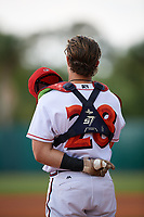 Florida Fire Frogs catcher Brett Cumberland (28) stands for the national anthem during a game against the Daytona Tortugas on April 7, 2018 at Osceola County Stadium in Kissimmee, Florida.  Daytona defeated Florida 4-3.  (Mike Janes/Four Seam Images)