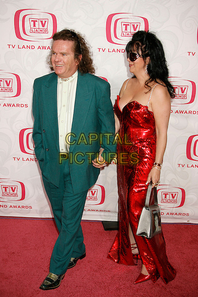 BUTCH PATRICK & GUEST.Attending the 5th Annual TV Land Awards - Arrivals,.held at Barker Hangar, Santa Monica, California, .USA, 14 April, 2007..full length red dress.CAP/ADM/RE.©Russ Elliot/AdMedia/Capital Pictures.