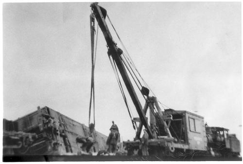 Derrick OP lifting derailed passenger car at Espanola accident scene.<br /> D&amp;RG  Espanola, NM  1921