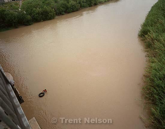 Guy with inner tube in the Rio Grande.<br />