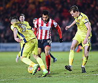 Lincoln City's Matt Green gets between Cheltenham Town's Ilias Chatzitheodoridis, left, and William Boyle, right<br /> <br /> Photographer Andrew Vaughan/CameraSport<br /> <br /> The EFL Sky Bet League Two - Lincoln City v Cheltenham Town - Tuesday 13th February 2018 - Sincil Bank - Lincoln<br /> <br /> World Copyright &copy; 2018 CameraSport. All rights reserved. 43 Linden Ave. Countesthorpe. Leicester. England. LE8 5PG - Tel: +44 (0) 116 277 4147 - admin@camerasport.com - www.camerasport.com