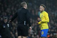 Neymar Jr of Brazil has a few words with referee, Craig Pawson during Brazil vs Uruguay, International Friendly Match Football at the Emirates Stadium on 16th November 2018
