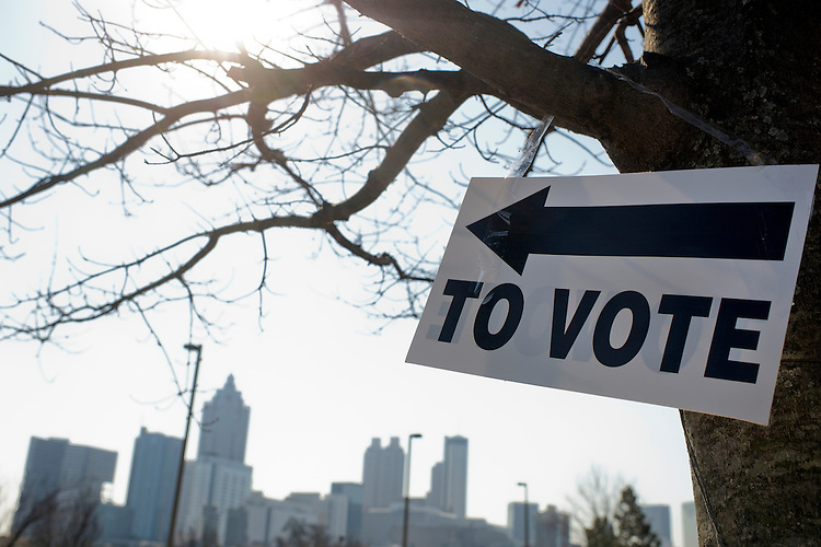 UNITED STATES - MARCH 1: A sign directing voters hangs on a tree at polling place near downtown Atlanta, Ga., March 1, 2016. (Photo By Tom Williams/CQ Roll Call)