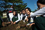 Worldview International Foundation works with the Basic Education High School on programs to create awareness on the the importance of mangroves, and other planting activities. Every week, the students have to participate in a development program at school. When this photo was taken, the students had to weed their school lawns.