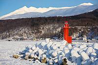 Hokkaido Island, Japan<br /> Red port lighthouse at the Utoro fishing village pier, on the Shiretoko Peninsula