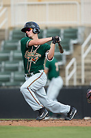 Micah Brown (17) of the Greensboro Grasshoppers follows through on his swing against the Kannapolis Intimidators at Kannapolis Intimidators Stadium on August 13, 2017 in Kannapolis, North Carolina.  The Grasshoppers defeated the Intimidators 4-1 in 10 innings in the completion of a game suspended on August 12, 2017.  (Brian Westerholt/Four Seam Images)