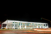 Brailia, DF, Brazil. Palacio do Planalto, President's offices. Iconic architecture by Oscar Niemeyer with swirling traffic.