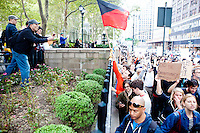 "There are many curious onlookers in Bryant Park as thousands of people march up 6th Avenue to Times Square on October 15, 2011 in New York City in support of the ""Occupy Wall Street"" movement."