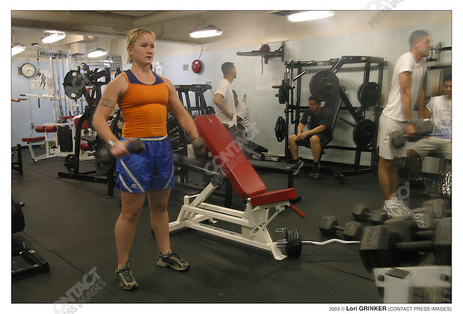 HN (hospital corpsman, based in San Diego) Elaine Gee works out in the gym at 10:30pm. USNS COMFORT Naval hospital ship in the Persian Gulf.