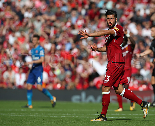 27th August 2017, Anfield, Liverpool, England; EPL Premier League football, Liverpool versus Arsenal; Emre Can of Liverpool shots instructions to his team mates