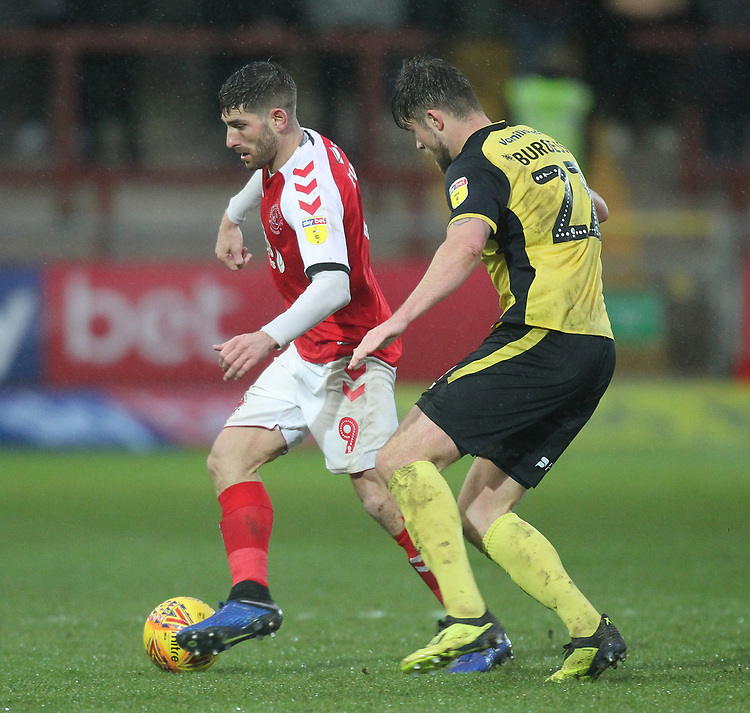 Fleetwood Town's Ched Evans in action with Scunthorpe Utd's Cameron Burgess<br /> <br /> Photographer Mick Walker/CameraSport<br /> <br /> The EFL Sky Bet League One - Fleetwood Town v Scunthorpe United - Saturday 26th January 2019 - Highbury Stadium - Fleetwood<br /> <br /> World Copyright © 2019 CameraSport. All rights reserved. 43 Linden Ave. Countesthorpe. Leicester. England. LE8 5PG - Tel: +44 (0) 116 277 4147 - admin@camerasport.com - www.camerasport.com