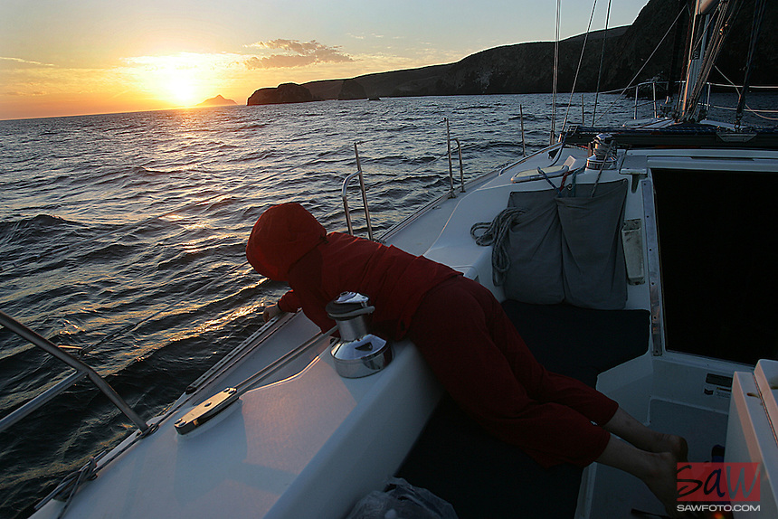 SANTA CRUZ ISLAND,CA - OCT. 26, 2007: Sarah Milligan-Toffler take in the sunrise view of East Santa Cruz Island Scorpion Anchorage, October 26, 2008.