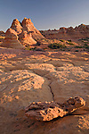 Cottonwood Teepees and surrounding patterned sandstone commonly found in the South Coyote Buttes area are illuminated by the evening sun