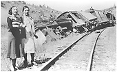 D&amp;RGW #477 K-28 derailed at Pounds Spur with two women standing alongside track.<br /> D&amp;RGW  Pounds Spur, CO  Taken by Dieckman, John - 5/1933