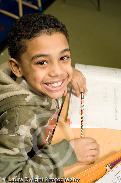 Education Elementary school Grade 2 male student smiling at camera viewer portrait vertical