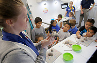 NWA Democrat-Gazette/DAVID GOTTSCHALK Sarah Martin, teaching artist describes Wednesday, October 3, 2018, the clay creature project to students at Walter Turnbow Elementary School, inside the Community Creative Center's Wheel Mobile Traveling Art Studio at the school in Springdale. The Wheel Mobile will spend two weeks at the school allowing the each second and third grade student an opportunity to participate in the activity inside the recreational vehicle.