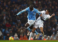 Yaya Toure of Manchester City and Jack Cork of Swansea City during the Barclays Premier League match between Manchester City and Swansea City played at the Etihad Stadium, Manchester on December 12th 2015