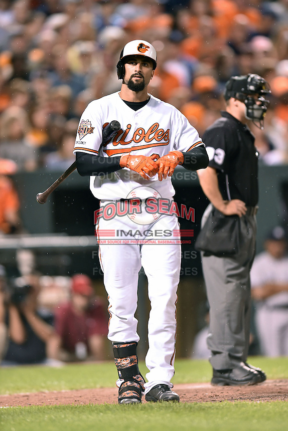 Baltimore Orioles right fielder Nick Markakis #21 during a game against the New York Yankees at Oriole Park at Camden Yards August 11, 2014 in Baltimore, Maryland. The Orioles defeated the Yankees 11-3. (Tony Farlow/Four Seam Images)