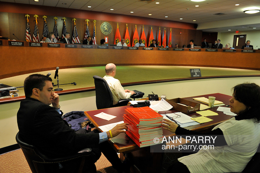 "Nassau County Legislature postpones vote on controversial merging of Police Precincts, on Monday, February 27, 2012. League of Women Voters members brought copies of ""A Citizen's Guide to Redistricting"" (red books on desk), and other attendees spoke about county's plans to merge police precincts and privatize sewage system."