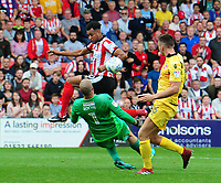 Morecambe's Barry Roche makes a close-range save under pressure from Lincoln City's Matt Green<br /> <br /> Photographer Chris Vaughan/CameraSport<br /> <br /> The EFL Sky Bet League Two - Lincoln City v Morecambe - Saturday August 12th 2017 - Sincil Bank - Lincoln<br /> <br /> World Copyright &copy; 2017 CameraSport. All rights reserved. 43 Linden Ave. Countesthorpe. Leicester. England. LE8 5PG - Tel: +44 (0) 116 277 4147 - admin@camerasport.com - www.camerasport.com