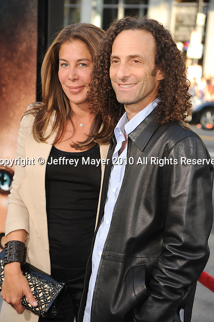 "HOLLYWOOD, CA. - June 02: Musician Kenny G (R) and Lyndie Benson arrive at the ""Splice"" Los Angeles Premiere at Grauman's Chinese Theater on June 2, 2010 in Hollywood, California."