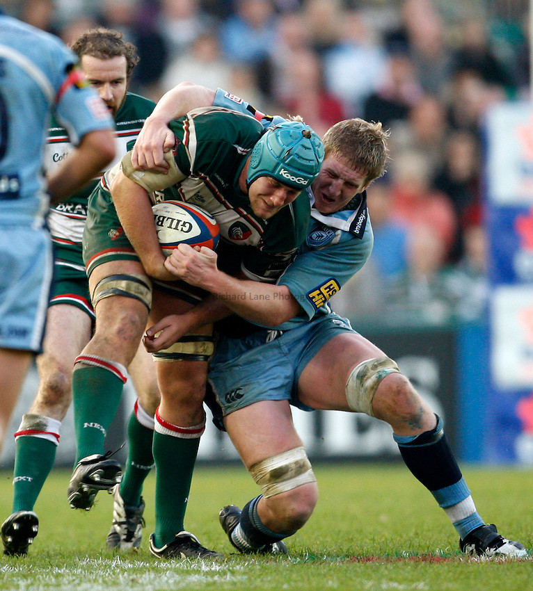Photo: Richard Lane/Richard Lane Photography..Leicester Tigers v Cardiff Blues. EDF Energy Cup. 03/11/2007. .Tigers' Jordan Crane is tackled by Blues' Bradley Davies.