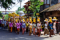 Bali, Gianyar, Mas. A hindu procession on their way to the temple with offerings.