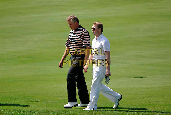 COLIN MONTGOMERIE & RONAN KEATING.At the Colin Montgomerie Charity Golf Tournament, .Golfclub Fontana, Baden bei Wien, Austria,.4th June 2007..full length game sport club course.CAP/PPG.©Eckharter/People Picture/Capital Pictures. *** Local Caption *** 00310444
