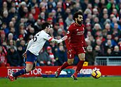 9th February 2019, Anfield, Liverpool, England; EPL Premier League football, Liverpool versus AFC Bournemouth; Mohamed Salah of Liverpool looks for support in midfield as he is closed down by Adam Smith of Bournemouth