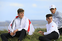 England team relax on the side of the green during Day 3 / singles of the Boys' Home Internationals played at Royal Dornoch Golf Club, Dornoch, Sutherland, Scotland. 09/08/2018<br /> Picture: Golffile | Phil Inglis<br /> <br /> All photo usage must carry mandatory copyright credit (&copy; Golffile | Phil Inglis)