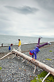 USA, Alaska, Homer, a family plays on the beach at Land's End beach, the Homer Spit
