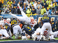Morgantown, WV - November 18, 2017: Texas Longhorns running back Daniel Young (32) dives for a touchdown during game between Texas and WVU at  Mountaineer Field at Milan Puskar Stadium in Morgantown, WV.  (Photo by Elliott Brown/Media Images International)