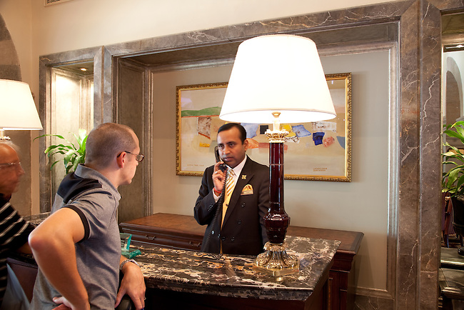 MUMBAI, INDIA - SEPTEMBER 27, 2010: The concierge sorts out a guest problem in the heritage wing reception area at the Taj Mahal Palace and Tower Hotel in Mumbai. The hotel has re-opened after the terror attacks of 2008 destroyed much of the heritage wing. The wing has been renovated and the hotel is once again the shining jewel of Mumbai. pic Graham Crouch
