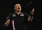29.12.2015. Alexandra Palace, London, England. William Hill PDC World Darts Championship. Raymond van Barneveld jumps into the air throwing his darts as he celebrates his shock win over Michael van Gerwen